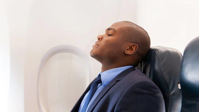 Man sleeping on an airplane
