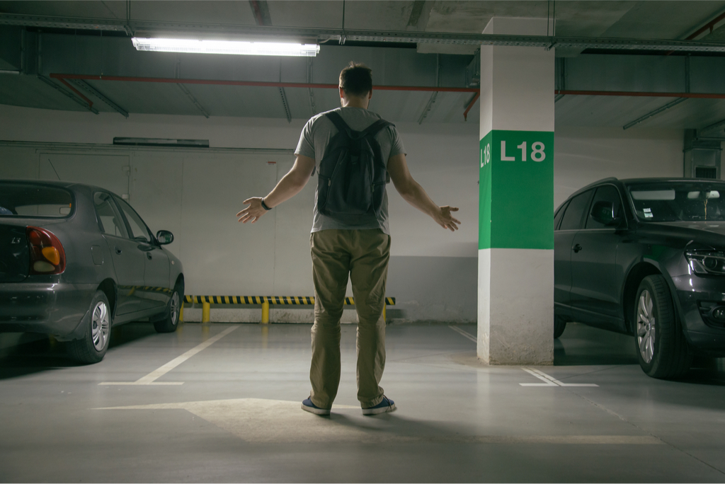 Man looking at parking spot where his car used to be
