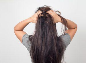 woman touches hair