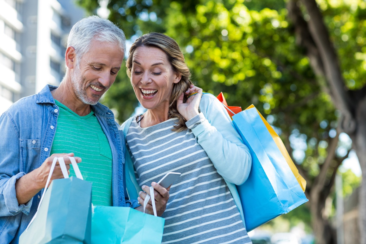 Middle age couple shopping happy