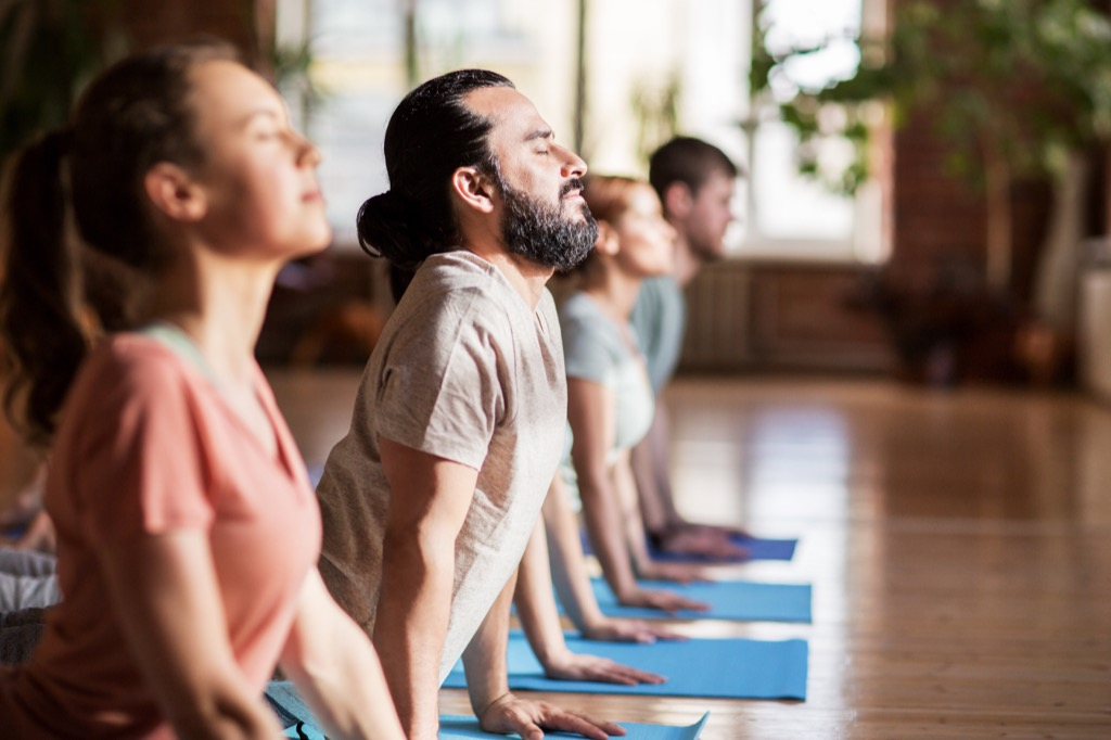 middle aged people doing yoga {Risks You Should Take}