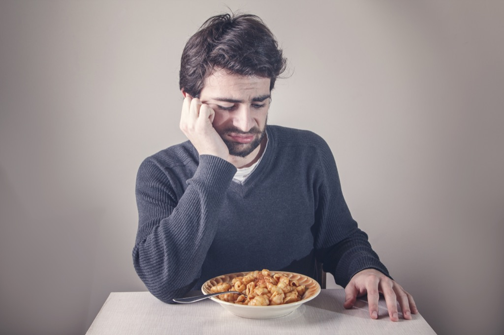 Man is not eating because he is not hungry