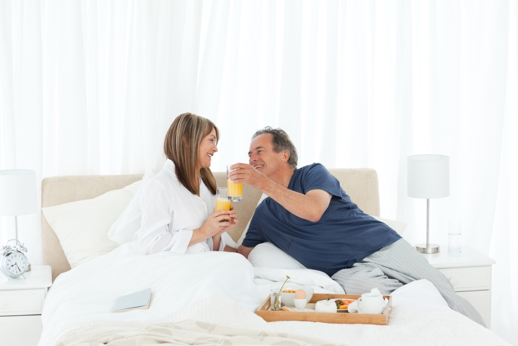 older couple in bed together, better wife after 40