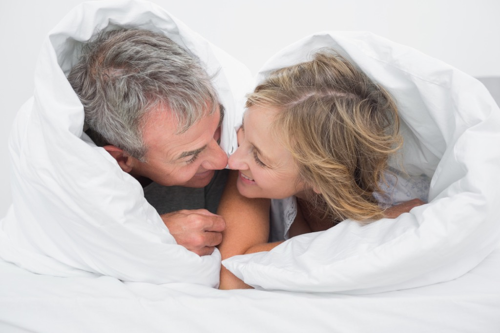 middle aged couple in bed