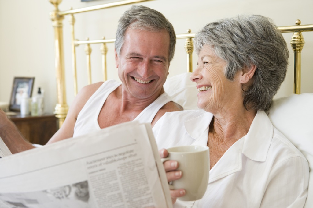 mature couple in bed, long marriage tips