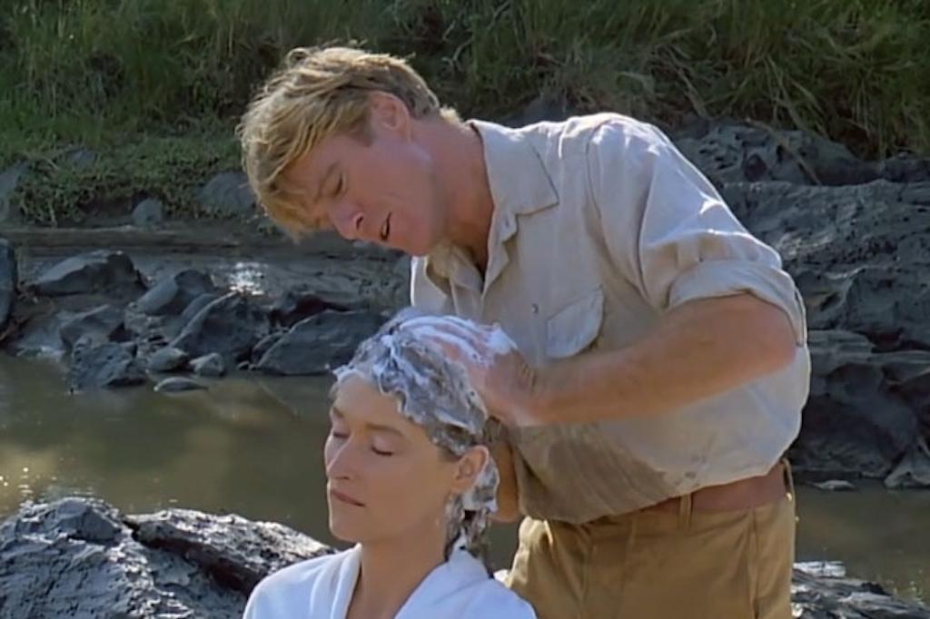 man washing woman's hair, romantic gestures