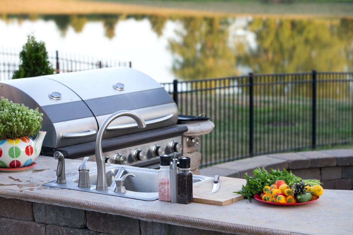 outdoor kitchen with stainless appliances