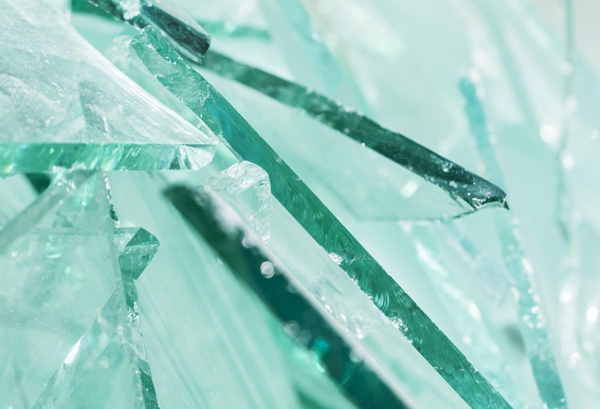 Broken glass pieces close up.