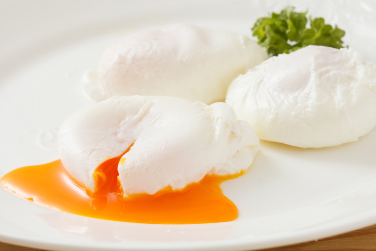 Yummy poached eggs with runny egg yolks