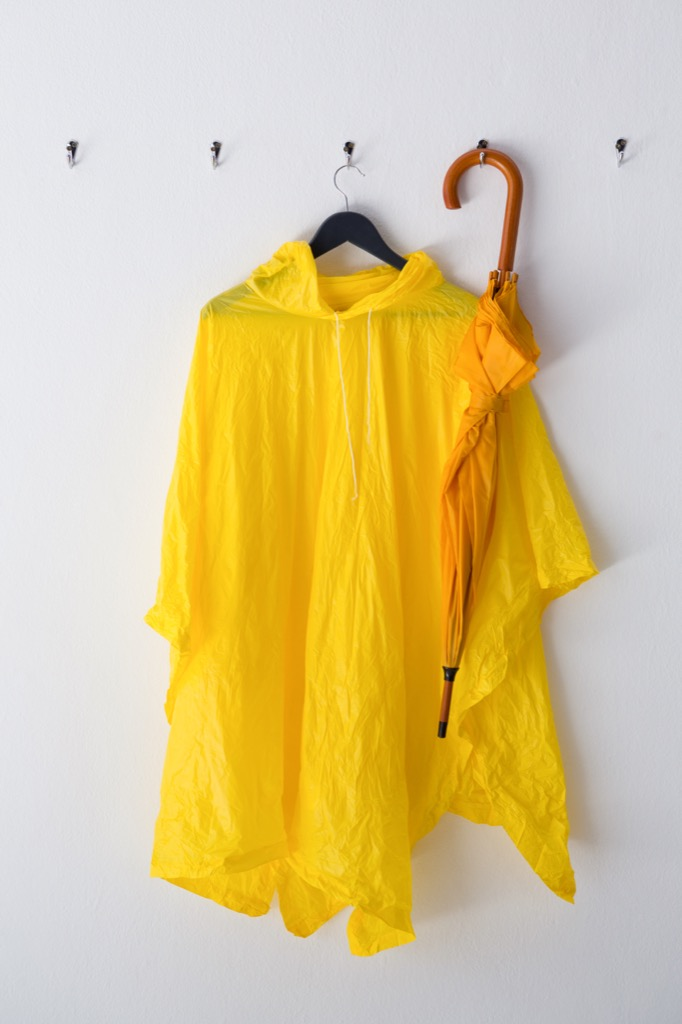 Raincoat and umbrella hanging on the wall