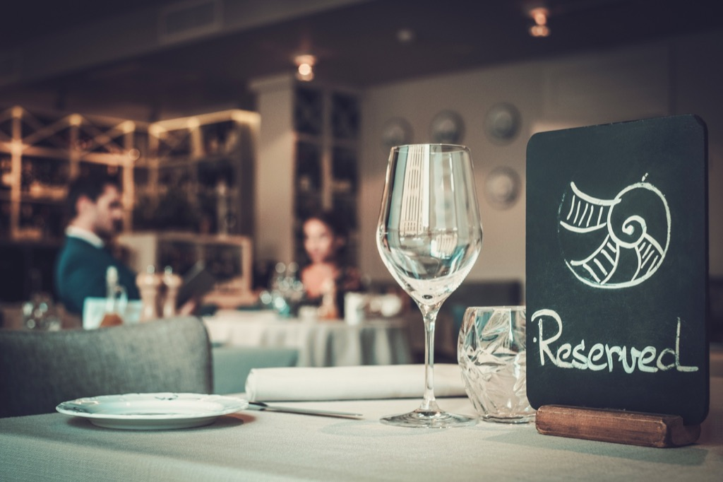 a reserved table sign in a fancy restaurant