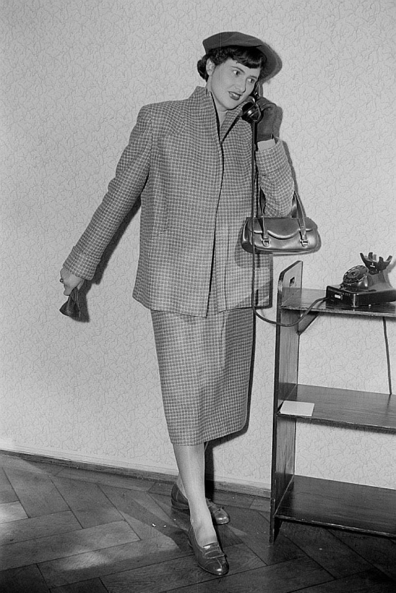 woman calling on rotary phone, 1950s photos