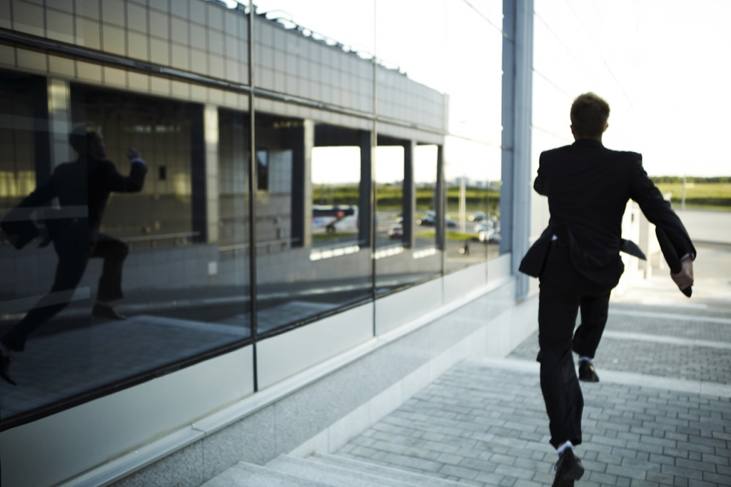Man in suit running away from something
