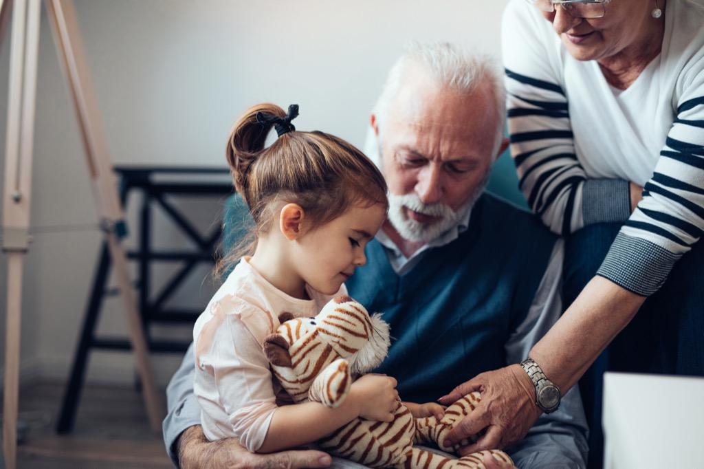 grandpa talking with granddaughter