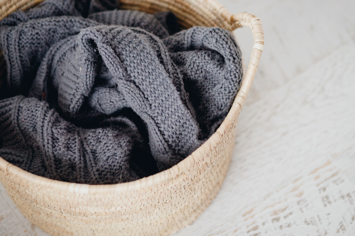 gray throw blanket in basket