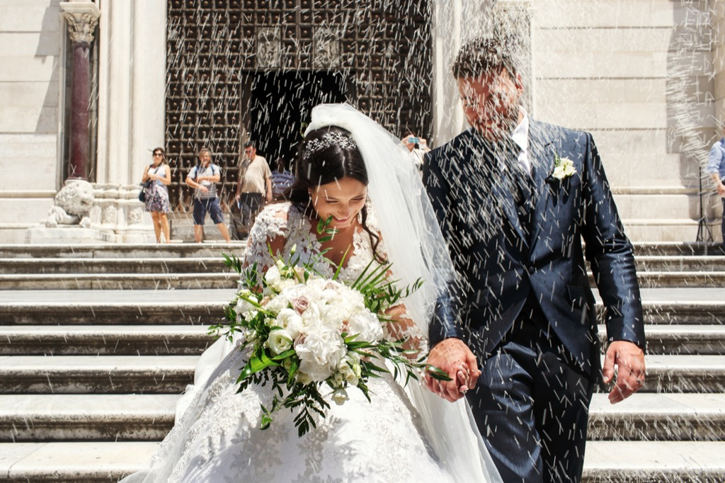 showering the newlyweds 20 Old-Fashioned Wedding Traditions That Nobody Does Anymore
