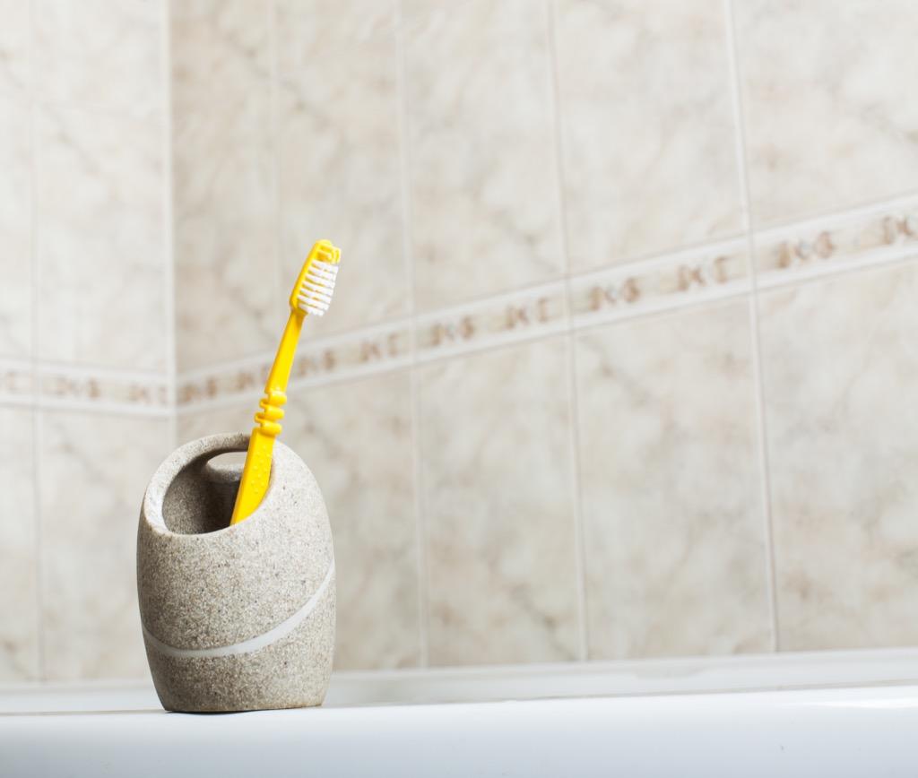 Toothbrush holder in the bathroom, things housekeepers hate