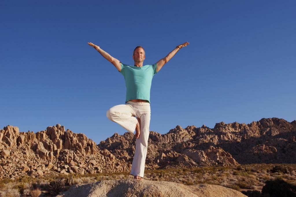 man doing yoga, tree pose