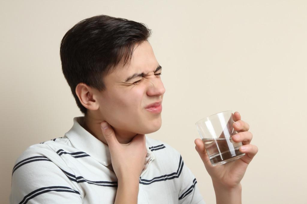 Man is having trouble swallowing