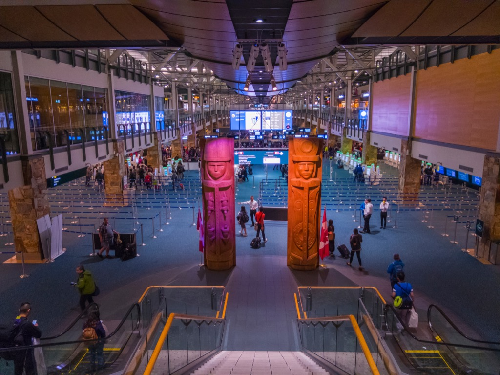 famous attraction of aquarium and sculptures inside vancouver international airport
