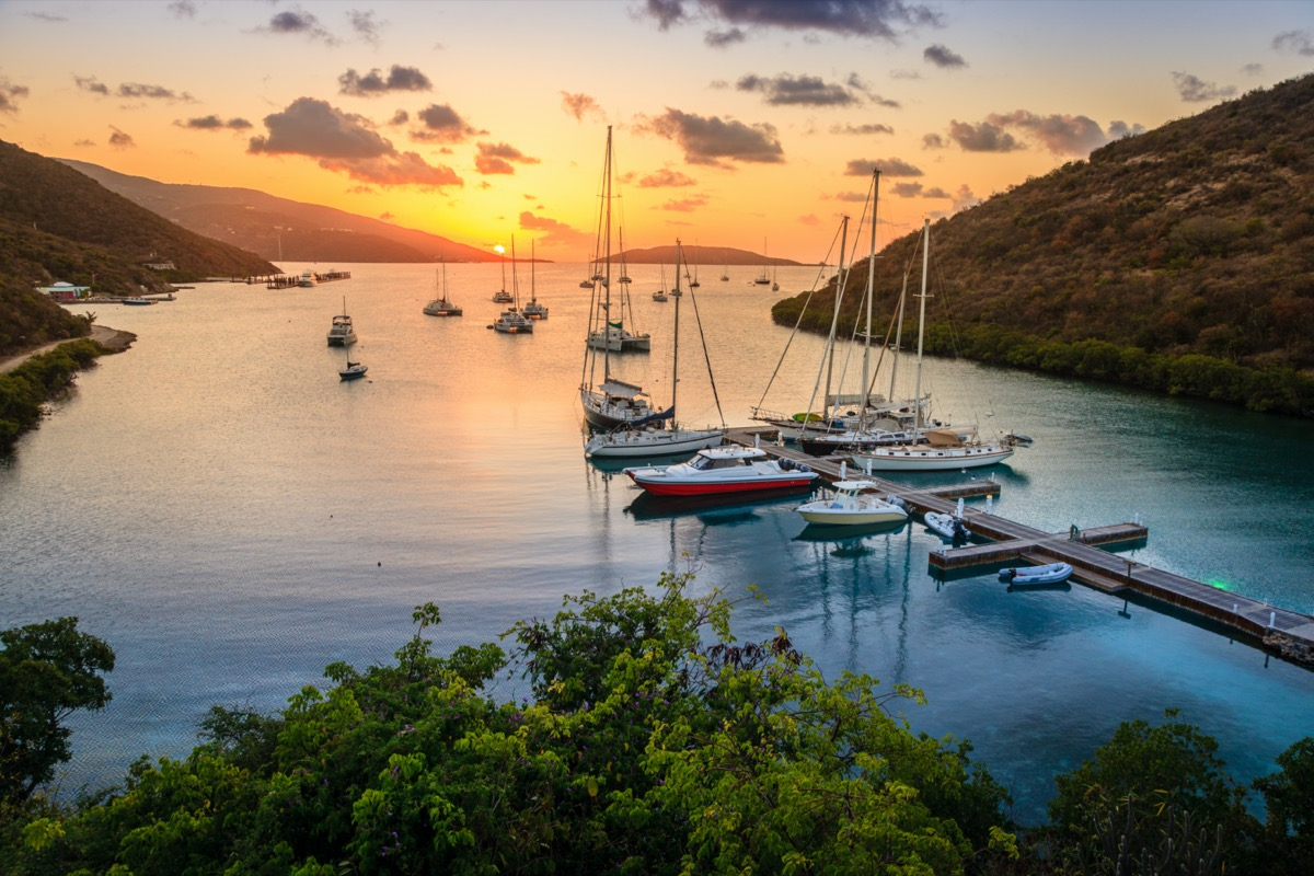 sunset over islands and boats
