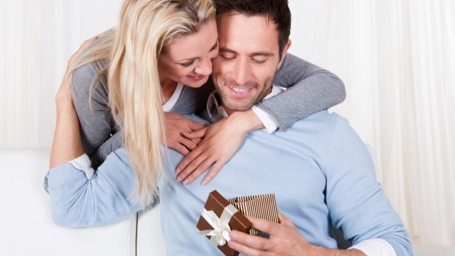 Wife is giving her husband a gift, cheating