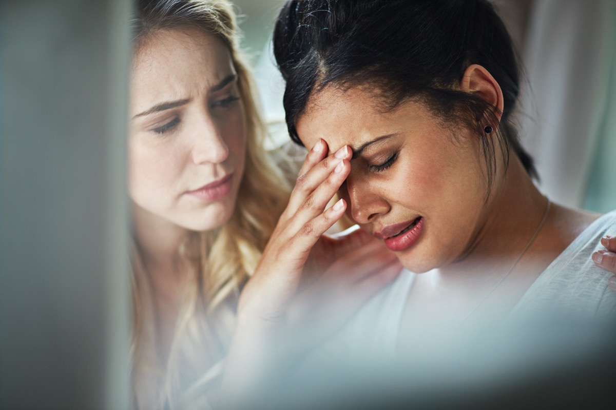 Shot of a young businesswoman consoling an upset colleague as they sit together in the office
