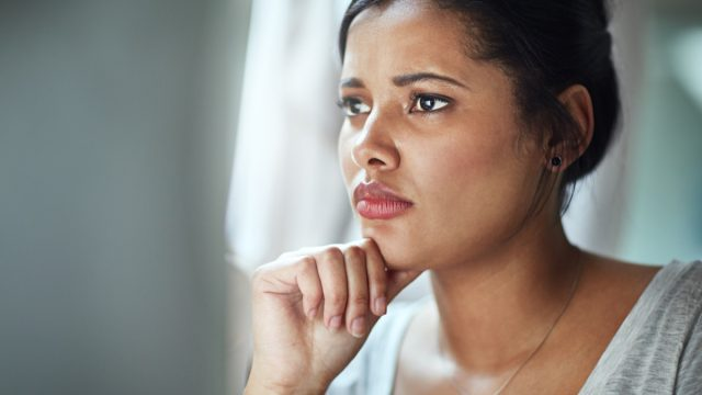 shot of an anxious young businesswoman looking at her computer screen while sitting in the office