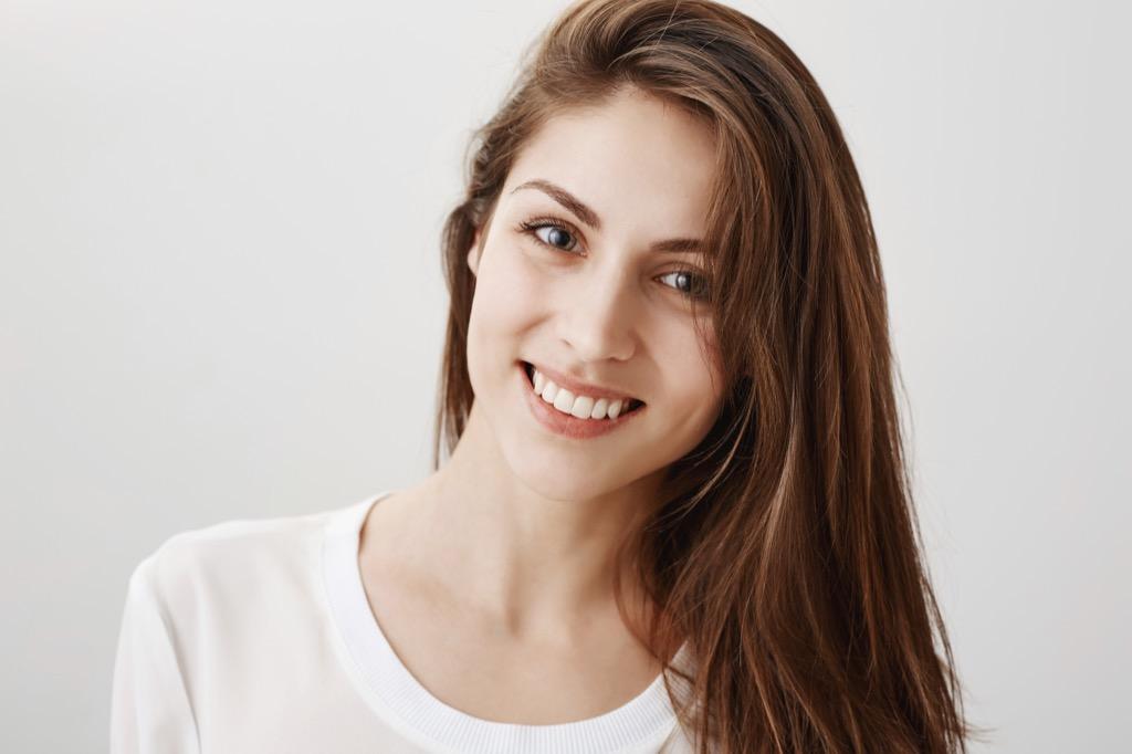 woman tilt gaze - what men find attractive in women