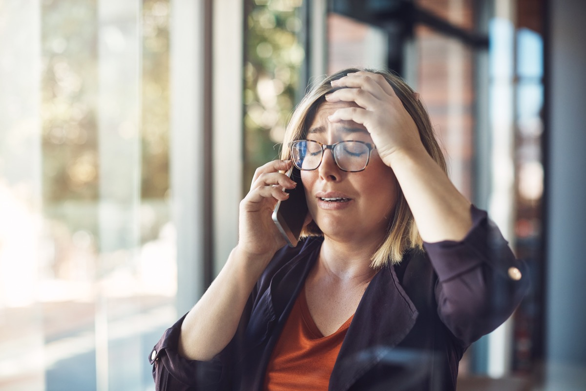 young woman distraught calling someone on the phone