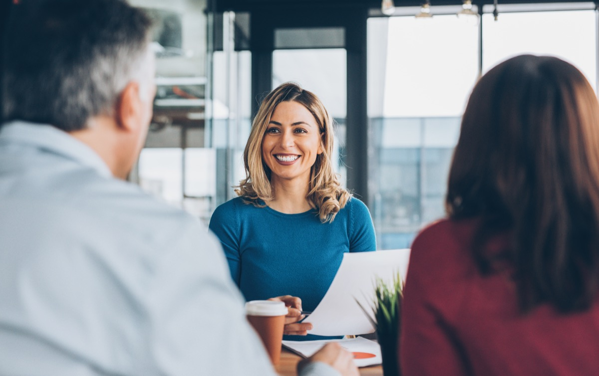 young woman talking to employers