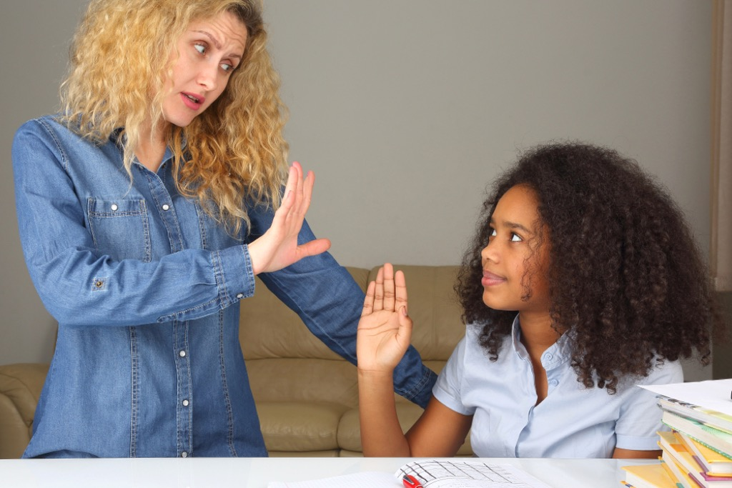 woman angry with daughter, stay at home mom