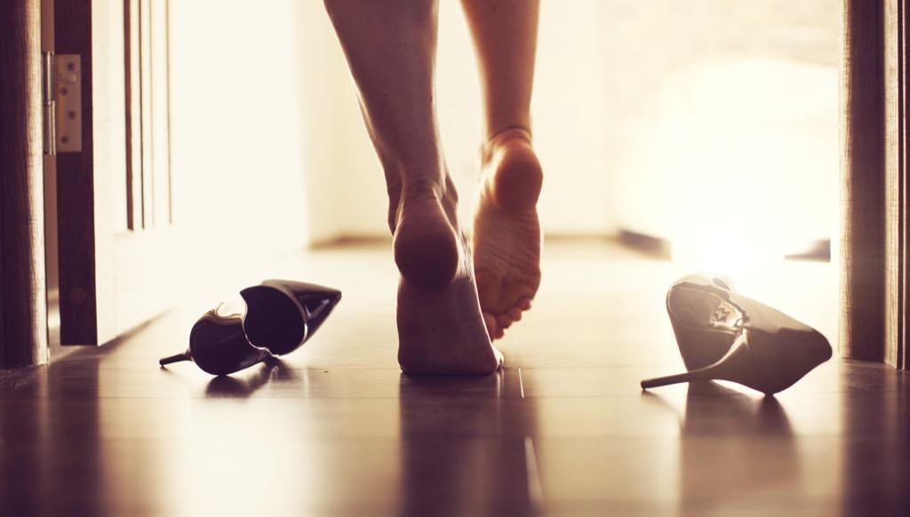 barefoot woman walking into bedroom