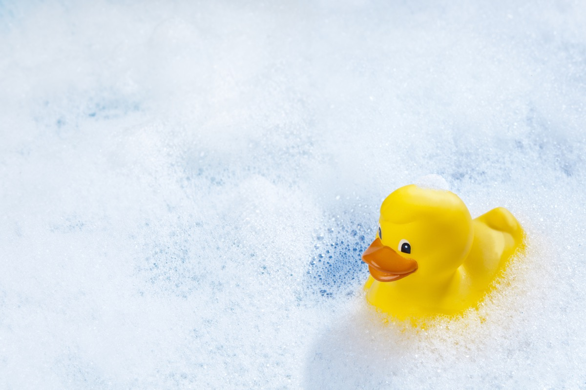 A yellow rubber duck in bathtub.