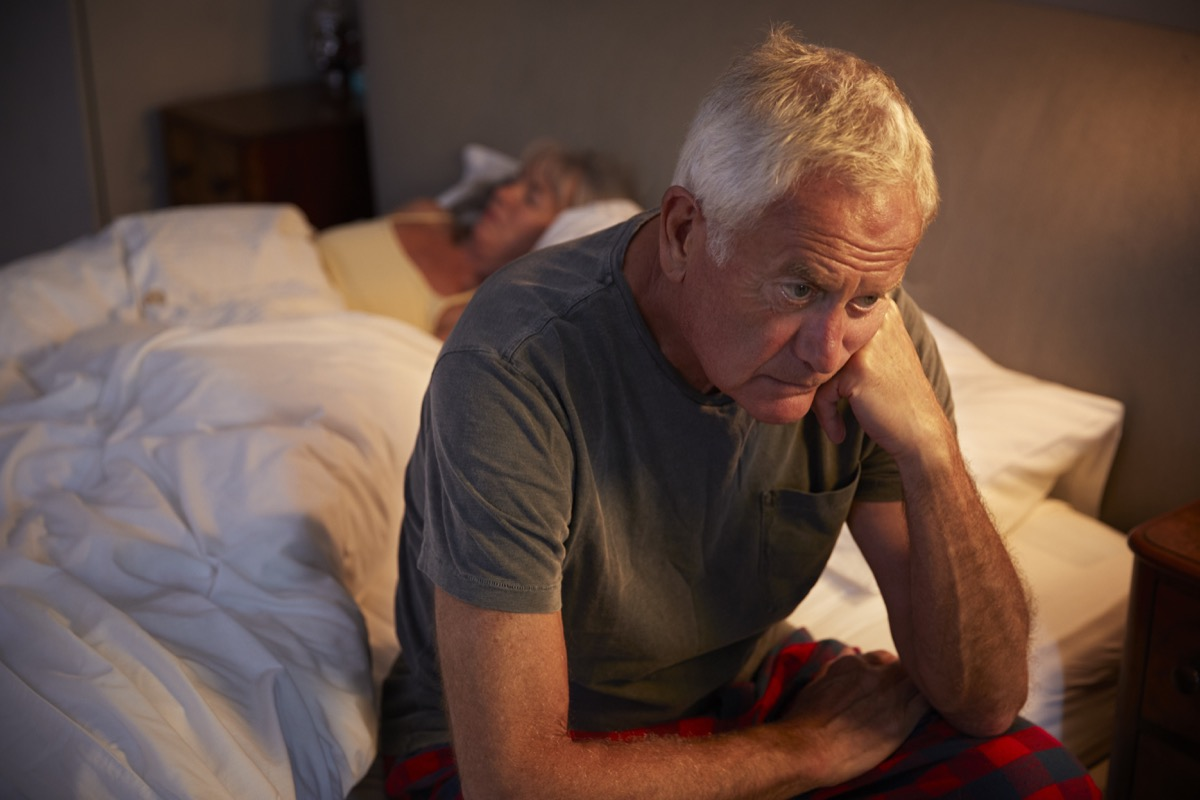 Man stressed in bed