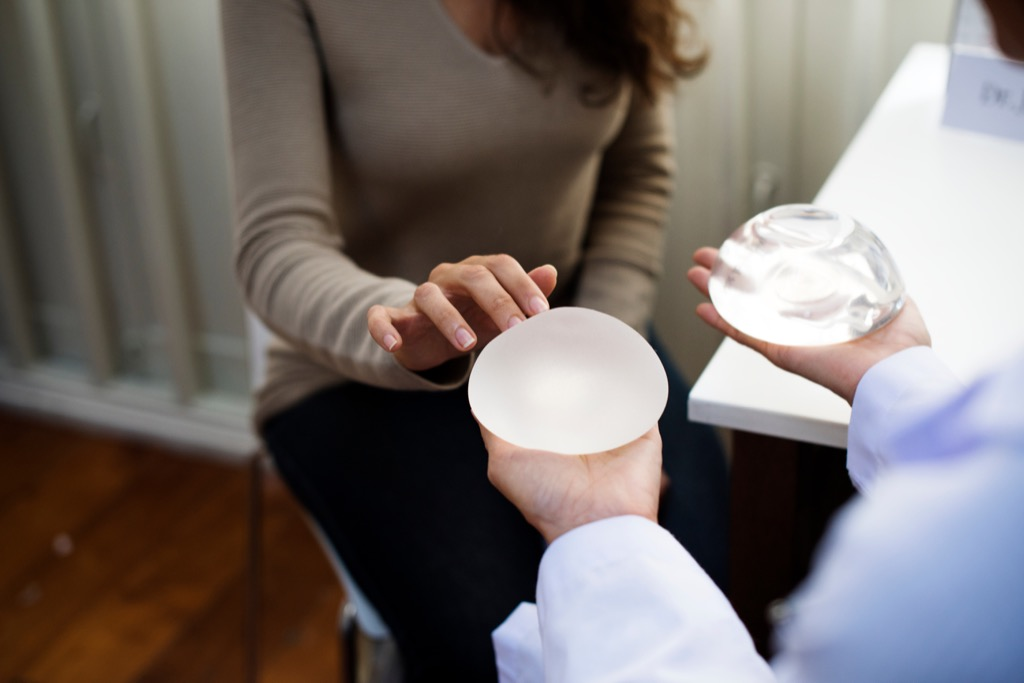woman consulting with a plastic surgeon about breast implants