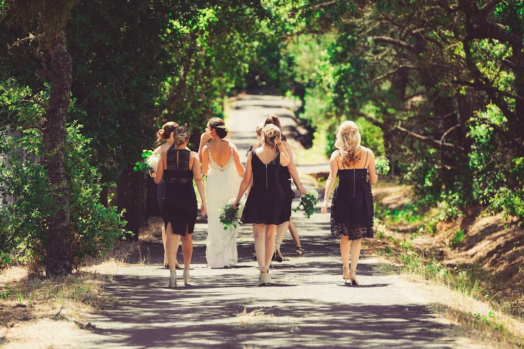 bride and bridal party walking to get photos taken