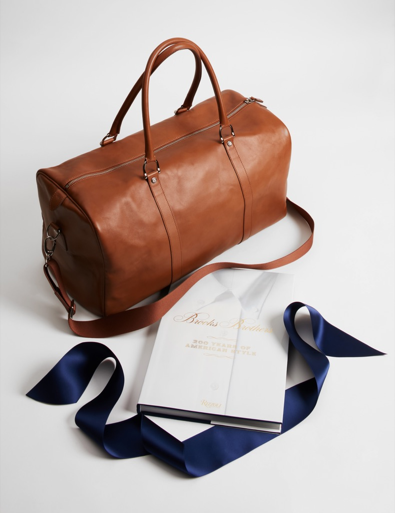 brooks brothers cognac leather duffel bag and 200 anniversary rizzoli book