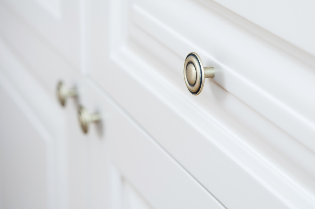 drawer pulls on white cabinets, signs your home is falling apart