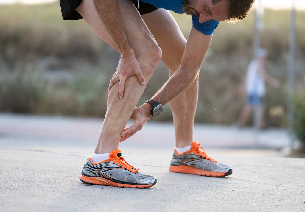 male runner suffering from a calf strain