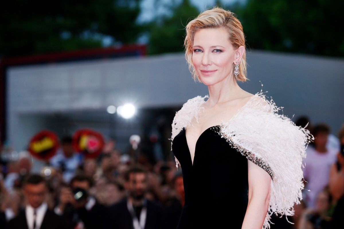 cate blanchett in white fur and a black dress looking more glamorous than anyone else on the planet