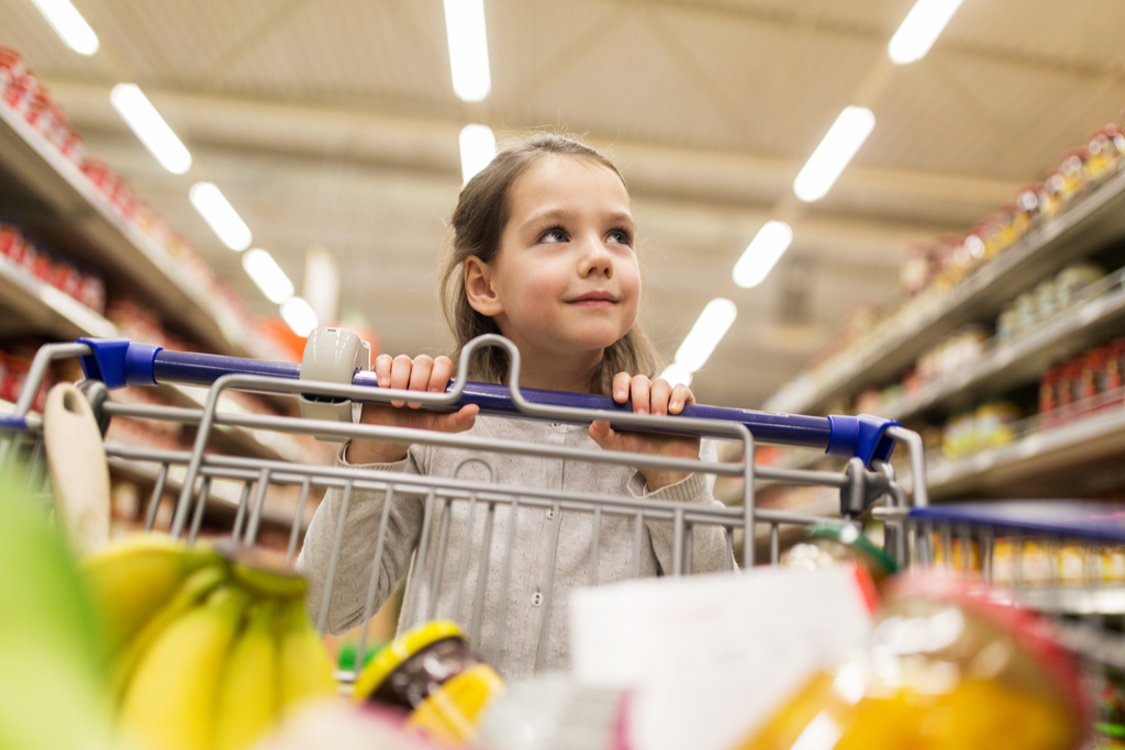 girl pushes grocery cart
