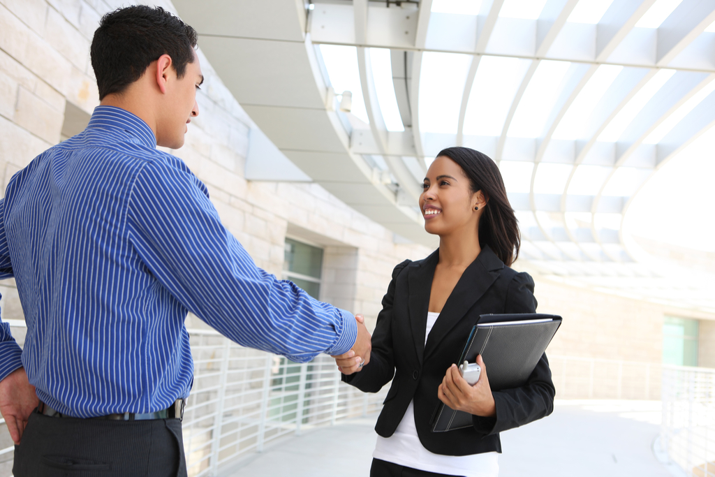 Coworkers Shaking Hands Reasons Smiling is Good for You