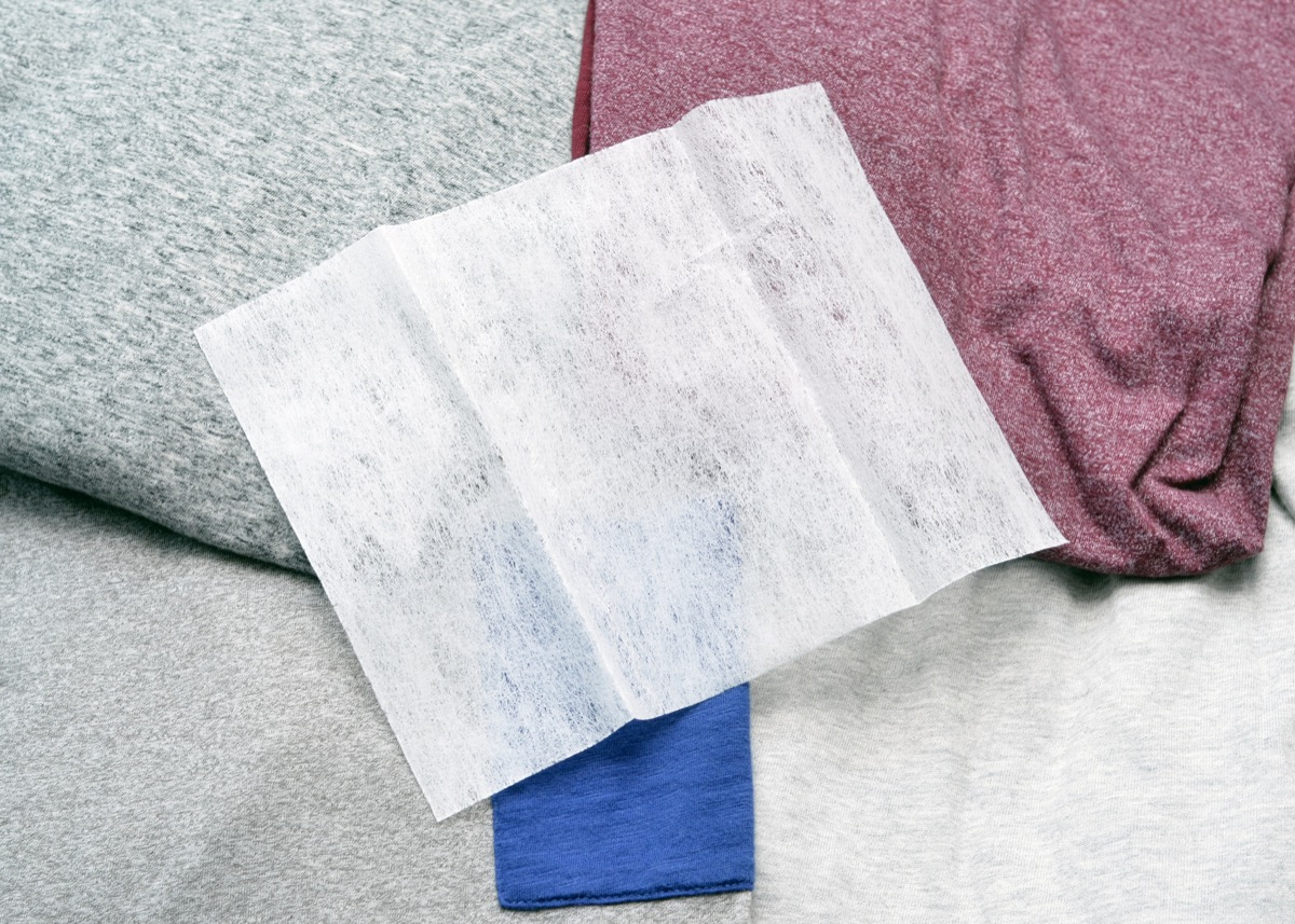 Close up of a generic fabric softener sheet on laundry.