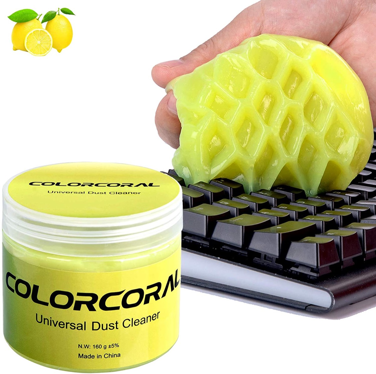 white hand using yellow putty to remove dust from keyboard