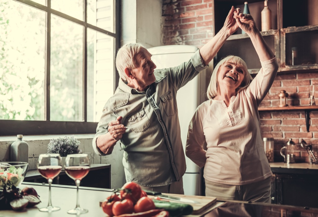elderly couple dancing in a kitchen