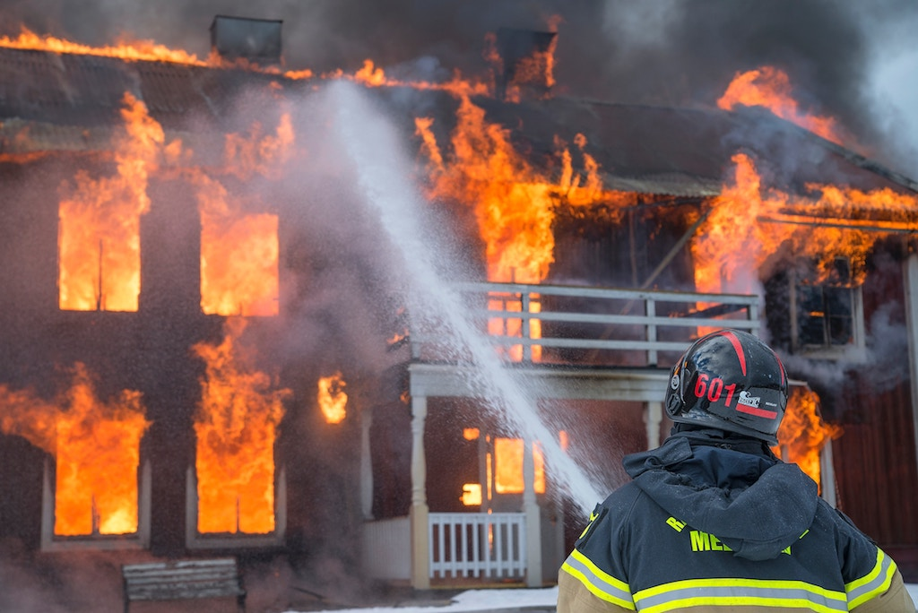 firefighter putting out a house fire, skin cancer facts
