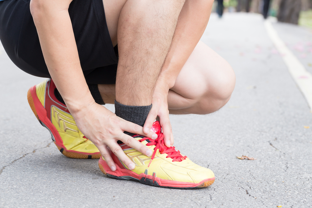 achilles tendon pain, man with a foot injury