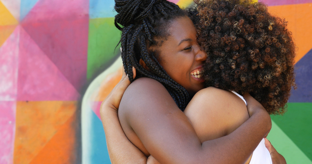 Friends Smiling and Hugging self-care tips