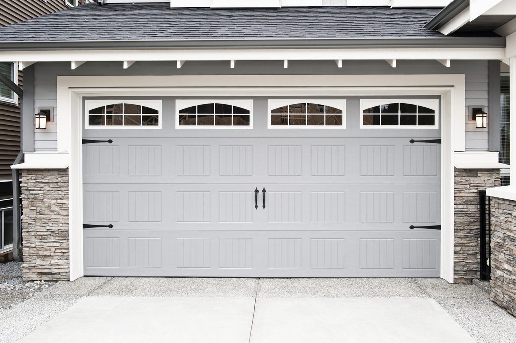 gray garage door with windows
